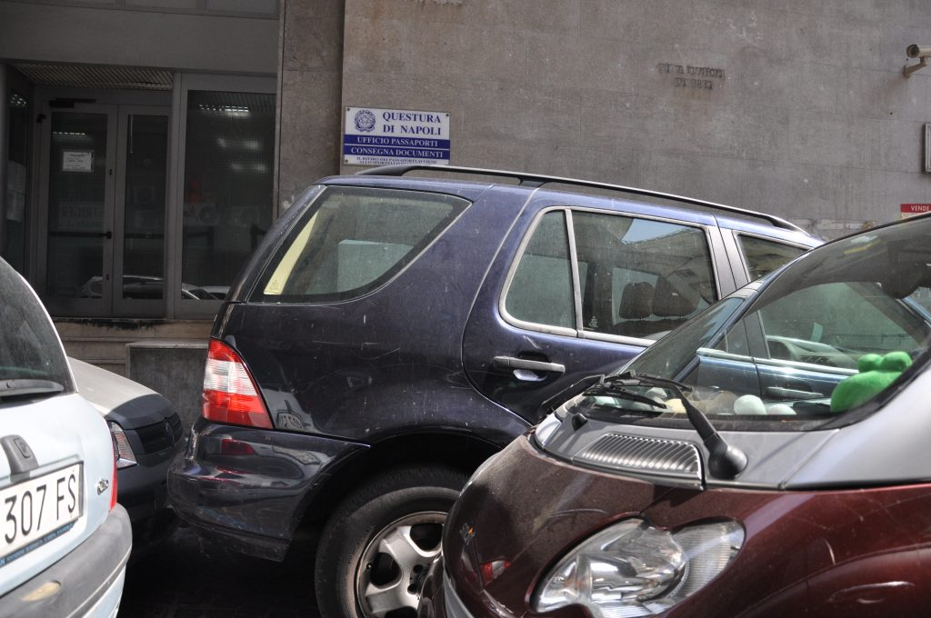 Double parked cars for post about driving in Italy tips
